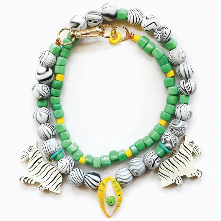 a colorful bracelet with a green stone