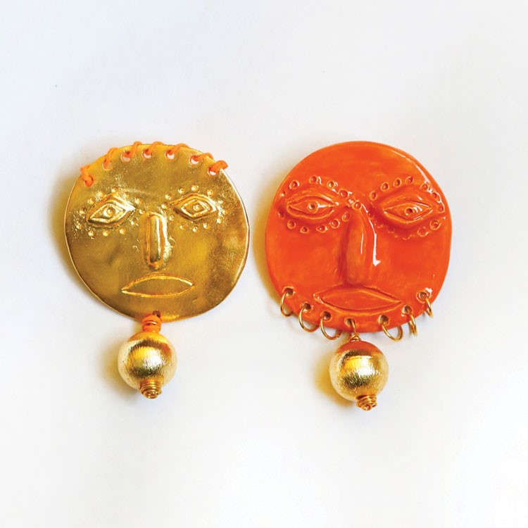 a group of gold and red earrings