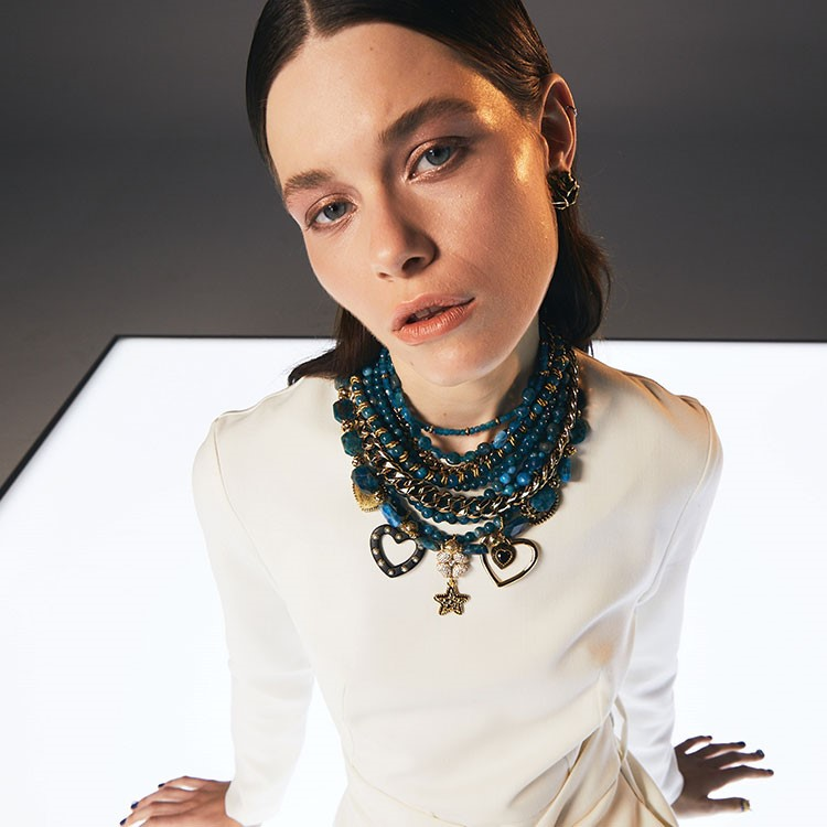 a woman with a necklace
