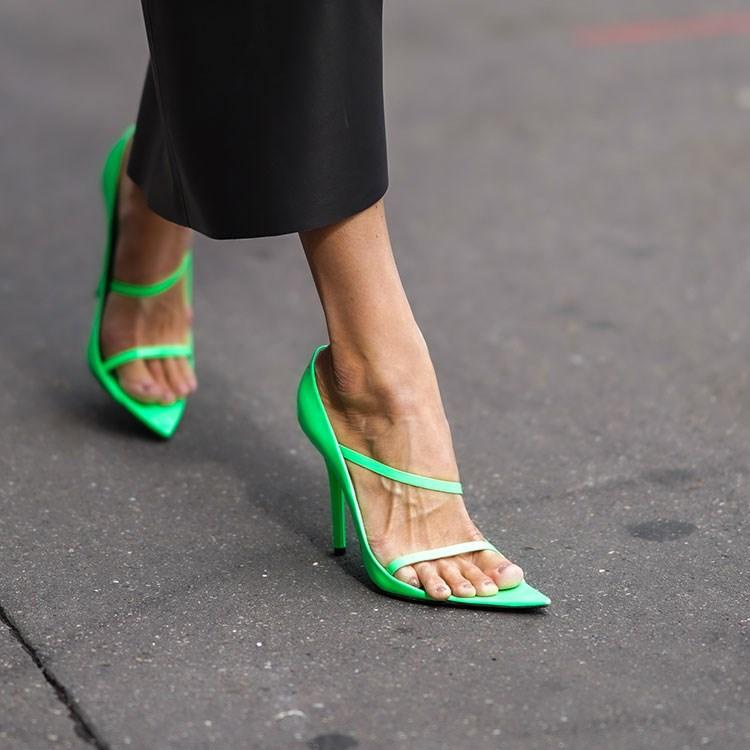 a person wearing green sandals
