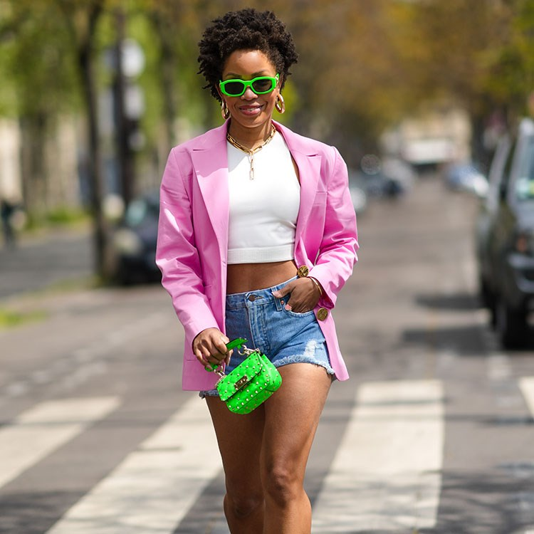 a woman in a pink jacket
