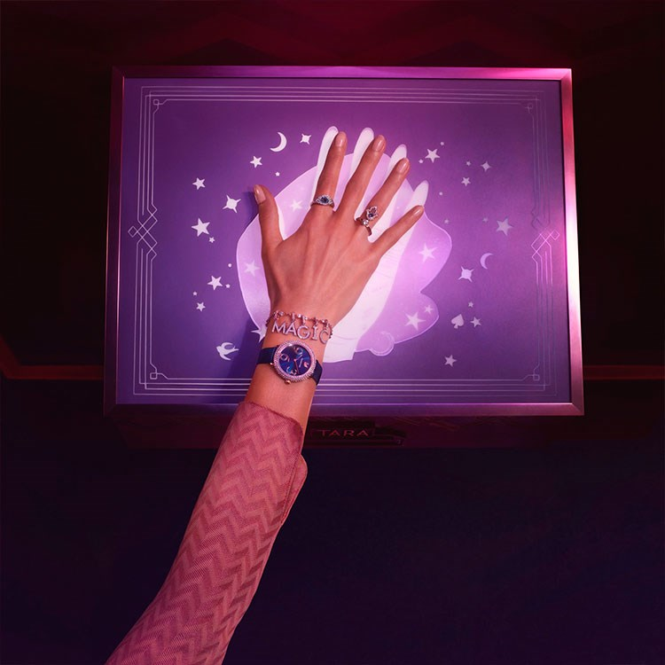a person holding their hands up in front of a screen