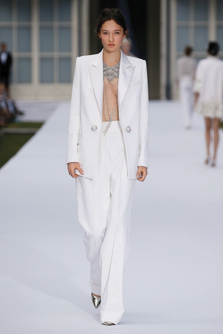 a person wearing a white suit