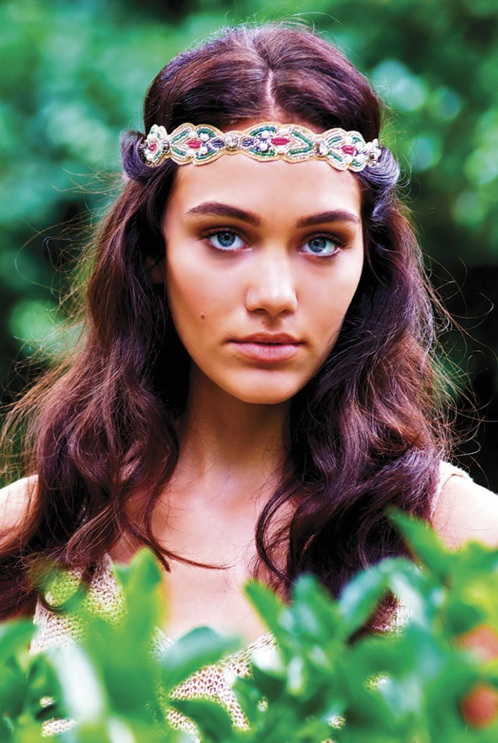 a person with a flower crown