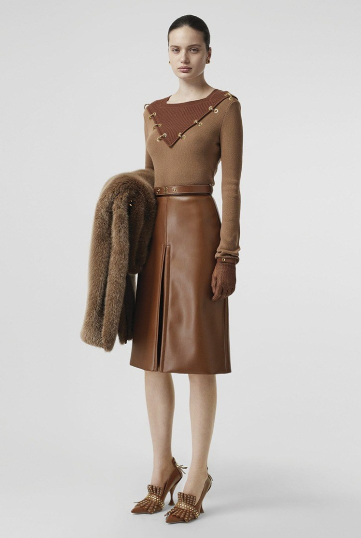 a woman in a brown dress
