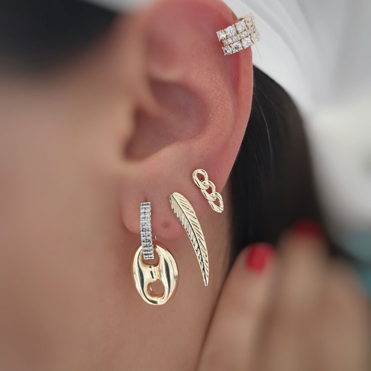 a close-up of a woman's ear with a ring