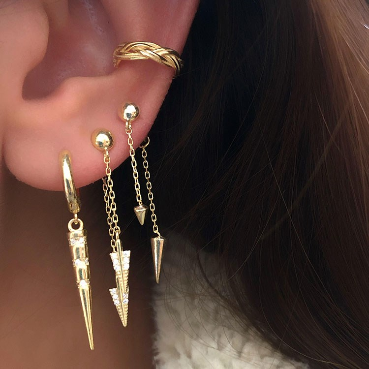 a close-up of a woman's earrings