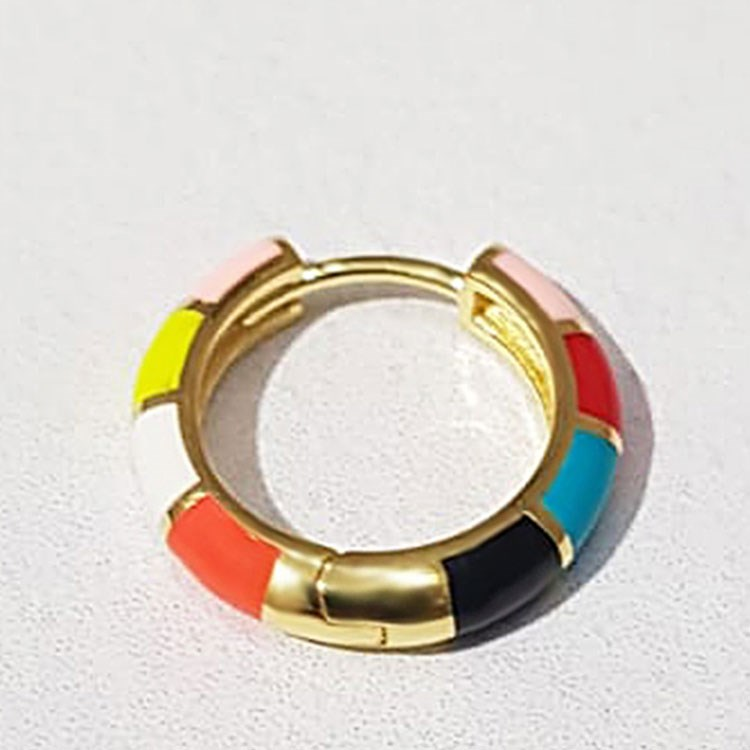 a gold and red ring