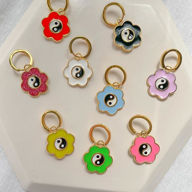 a group of colorful earrings