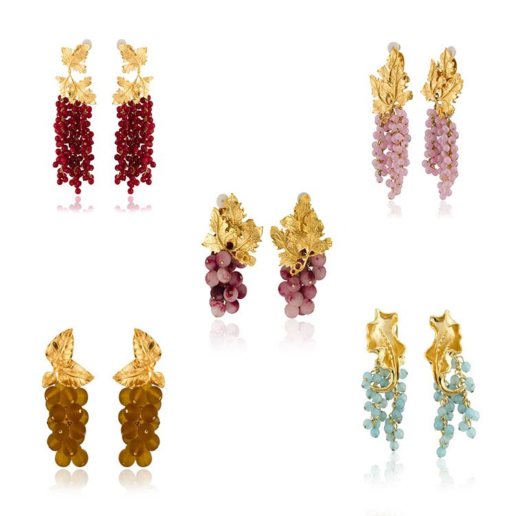 a group of different colored earrings