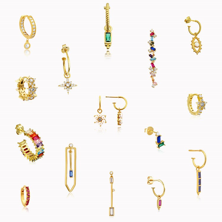a group of gold and silver earrings