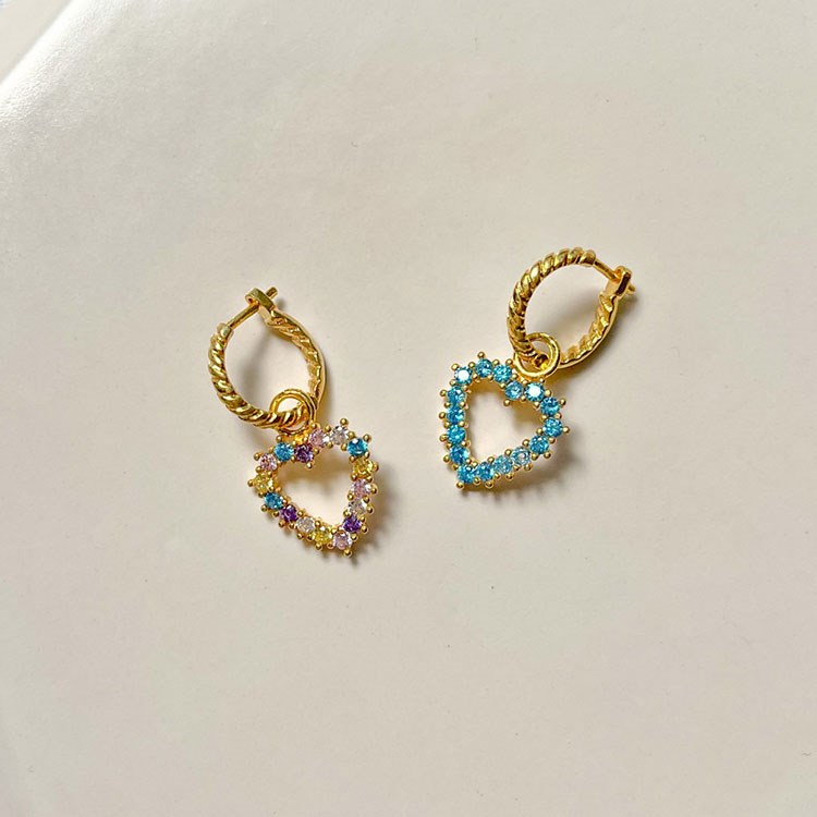 a pair of gold and blue earrings