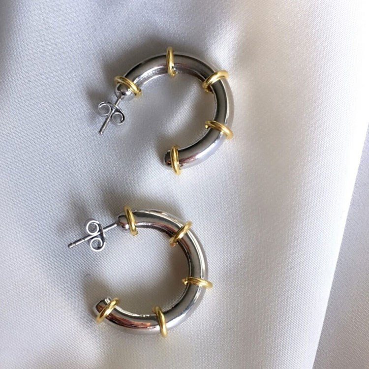 a pair of gold earrings