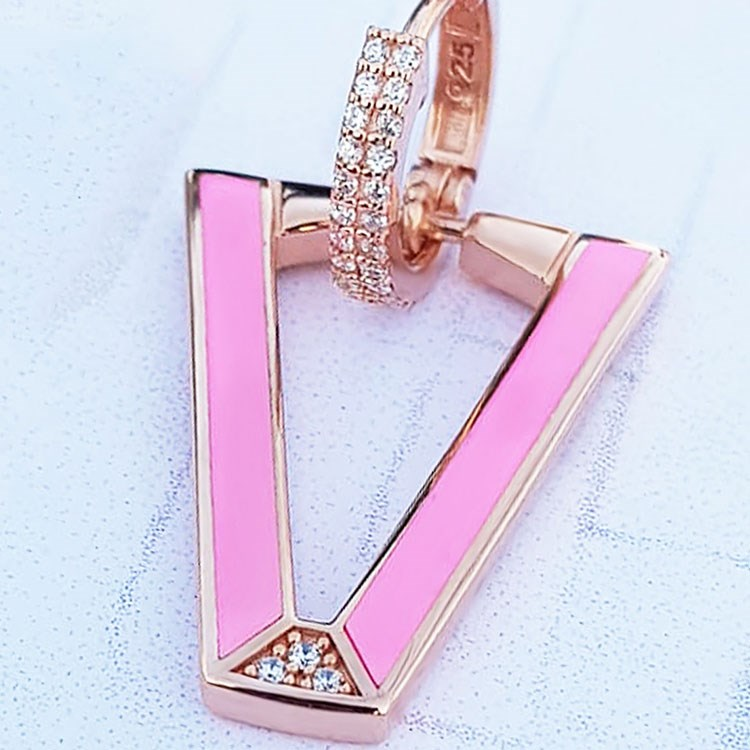 a pink box with a gold ring
