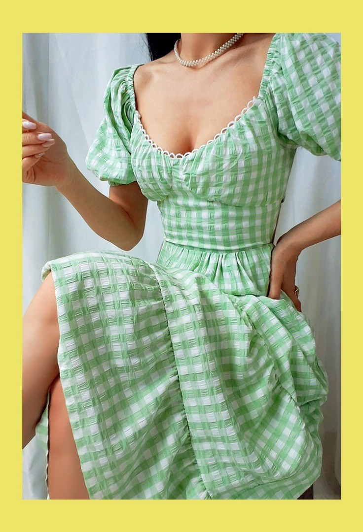 a person wearing a green dress