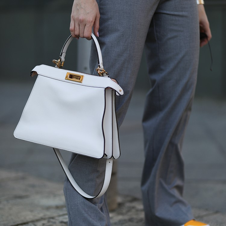 a person carrying a bag
