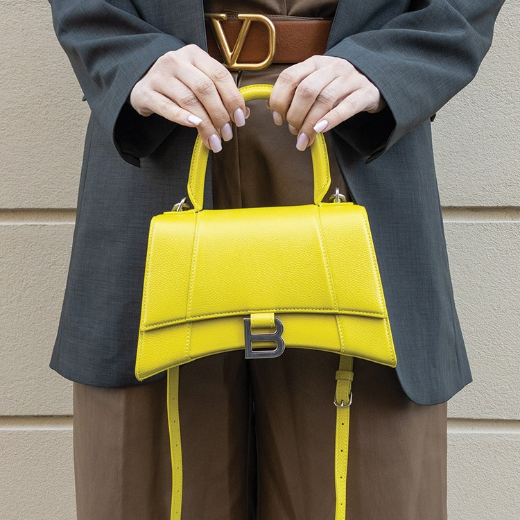 a person carrying a yellow bag