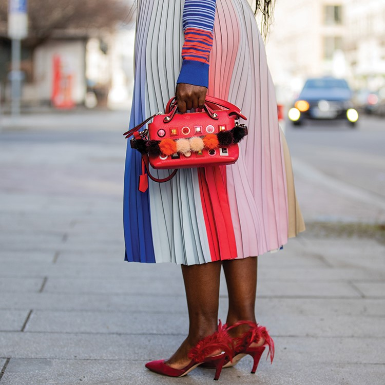 a person wearing a dress and holding a box of cookies