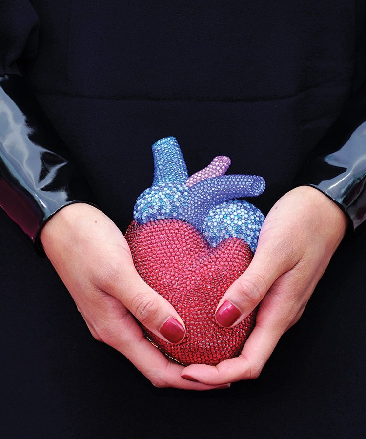a person holding a purple and blue object