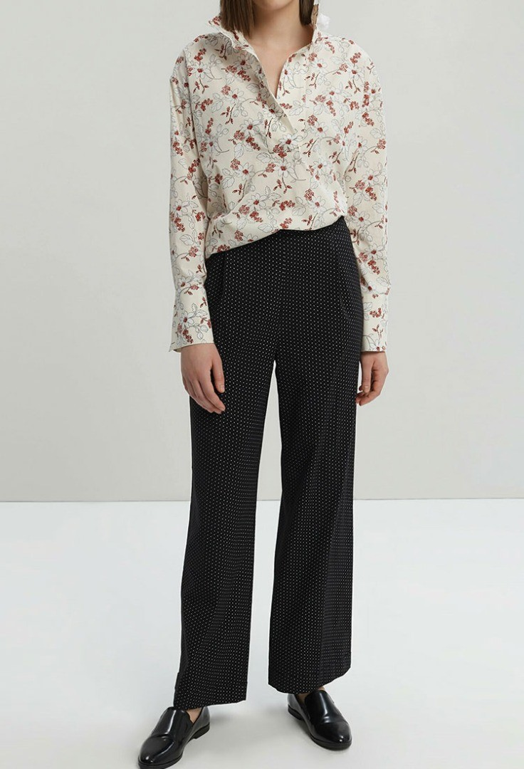 a person wearing a floral shirt