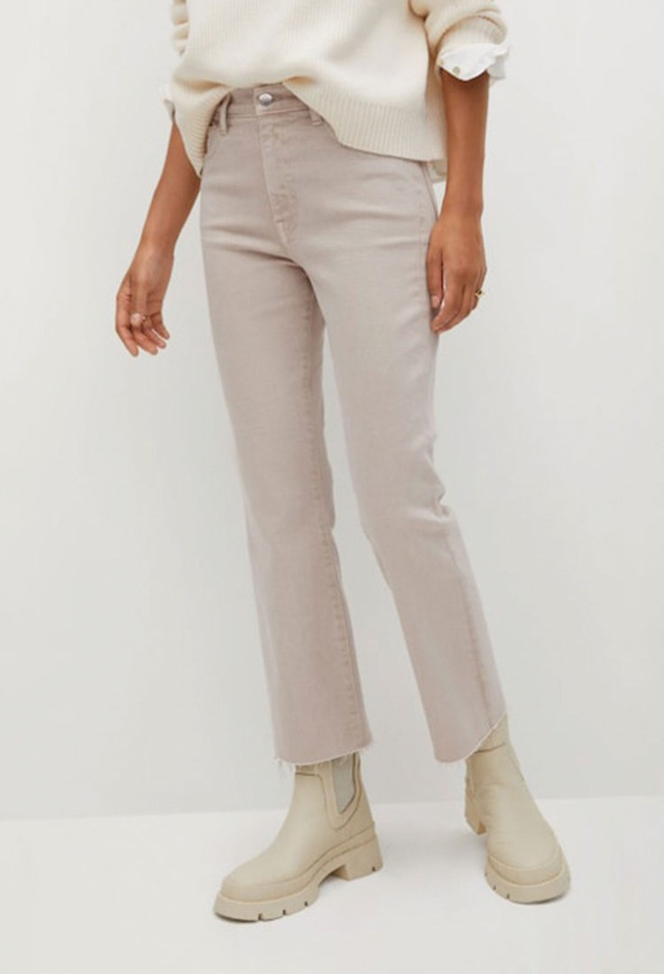 a person wearing a white shirt and beige pants