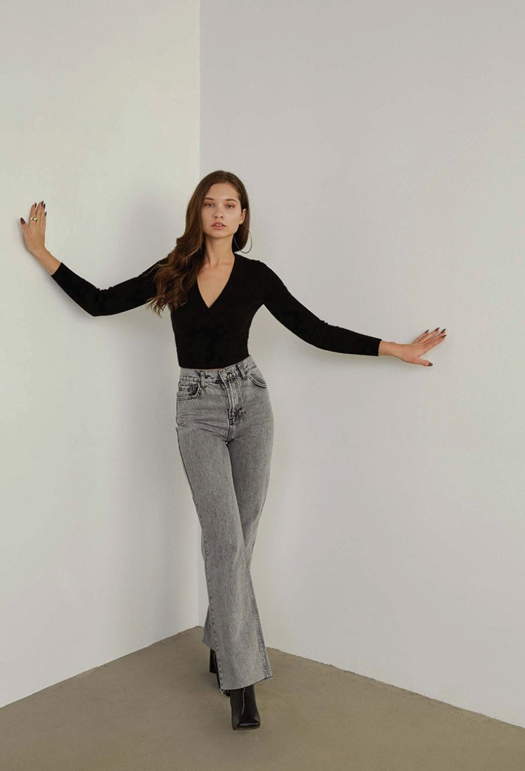a woman posing in a room