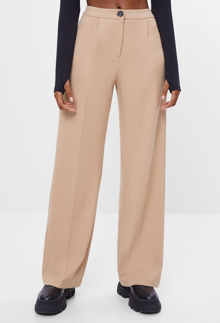 a woman's legs and pants