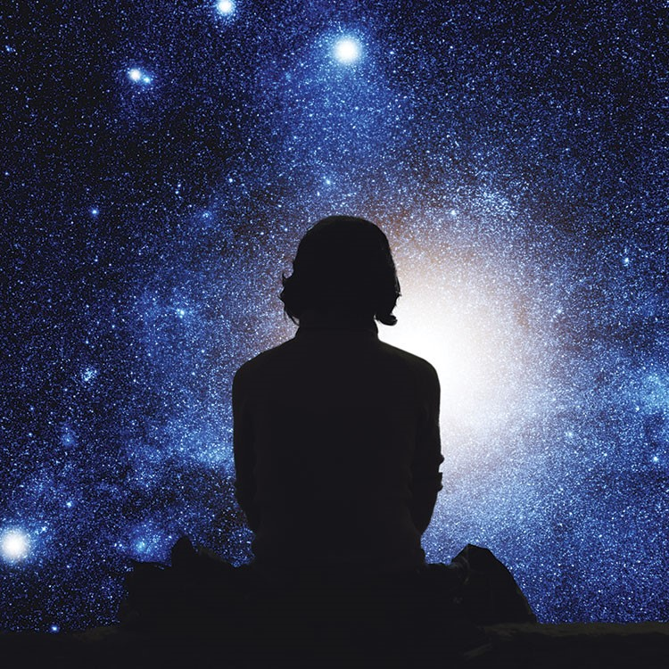 a person looking at the stars