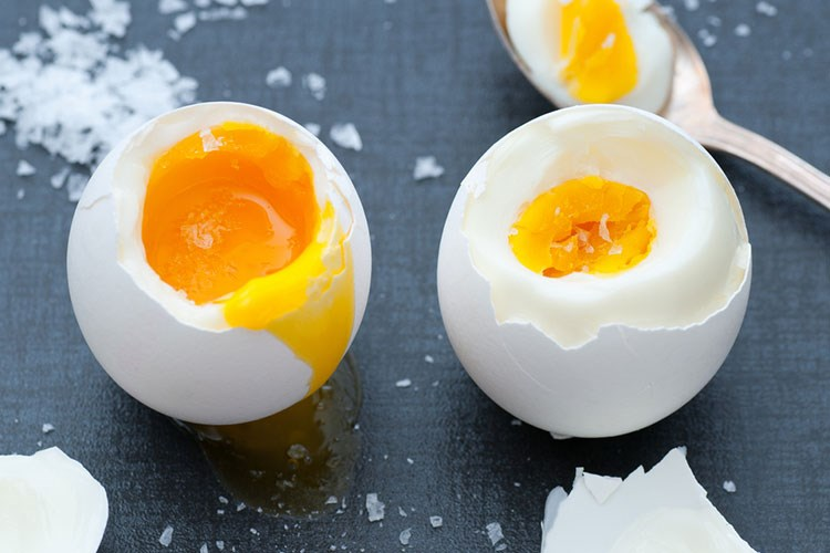 a couple of eggs with a spoon