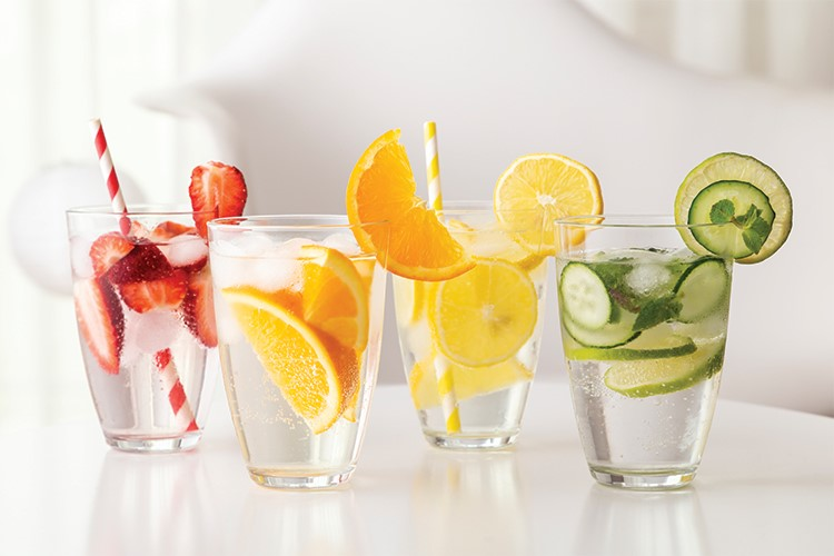 a group of drinks with fruit and ice