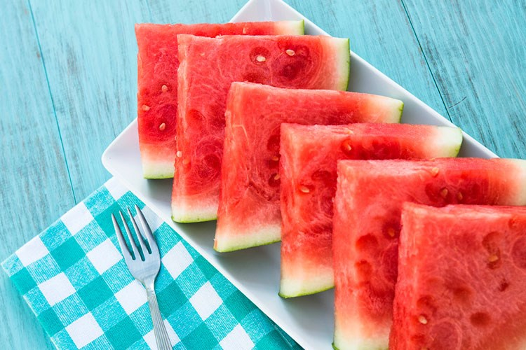 a plate of watermelon slices