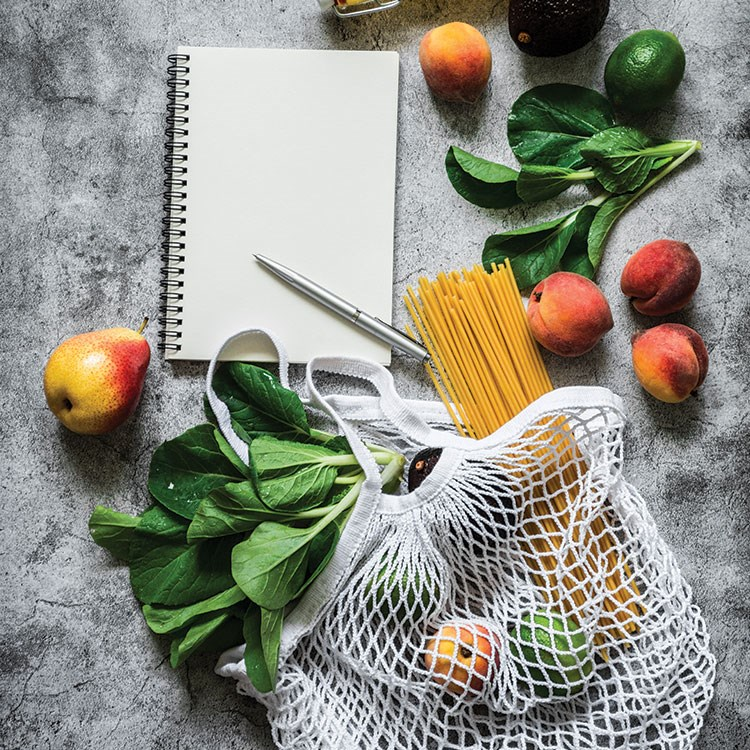 a basket of vegetables and a knife