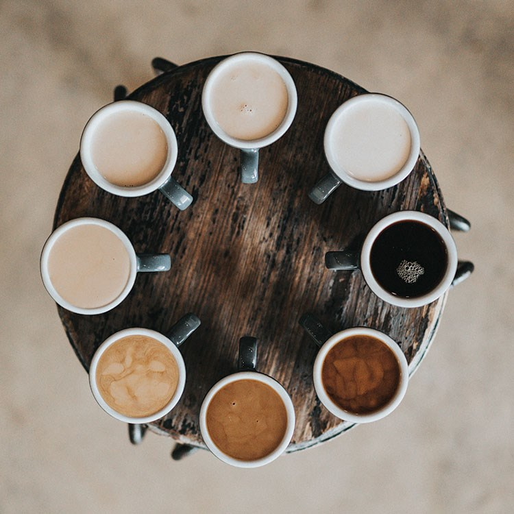 a group of cups with liquid in them