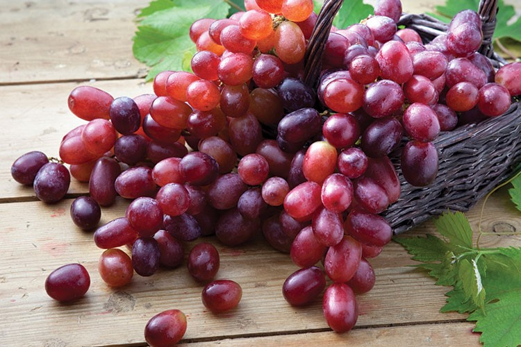 a basket of red grapes