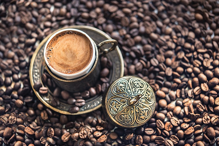 a ring on a pile of coffee beans