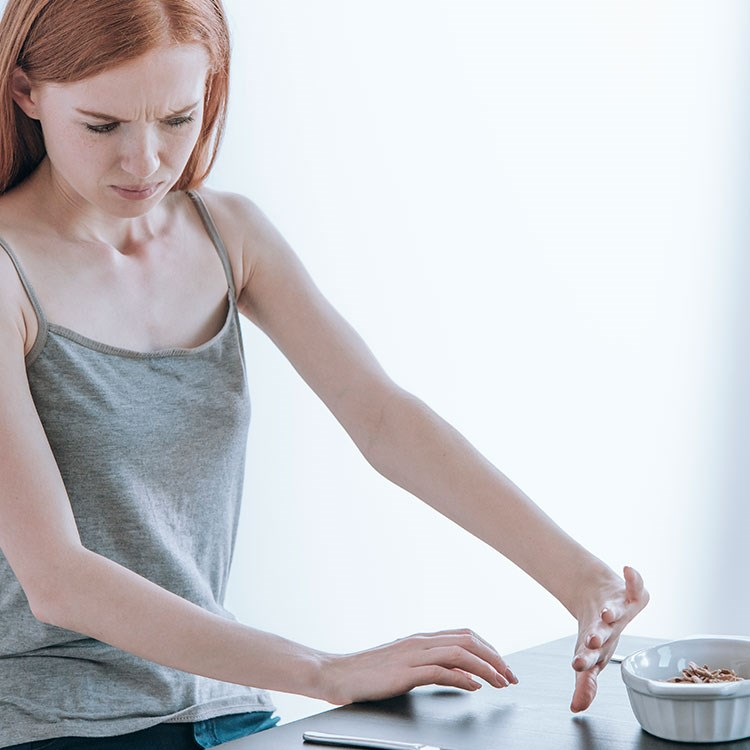 a woman with her hands on a table