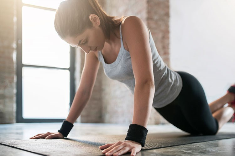 a woman working out on a table
