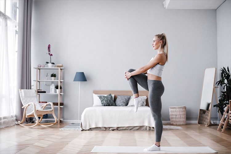 a woman stretching on a couch