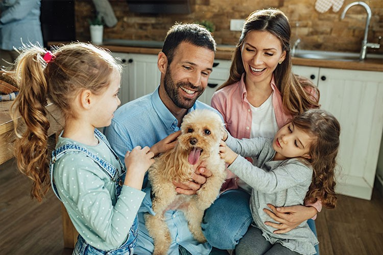 a family posing with a dog