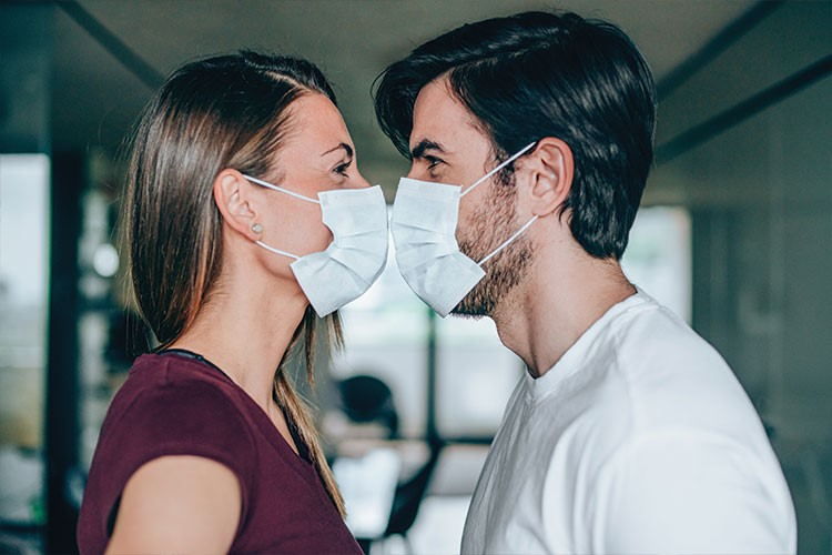 a man and a woman wearing masks