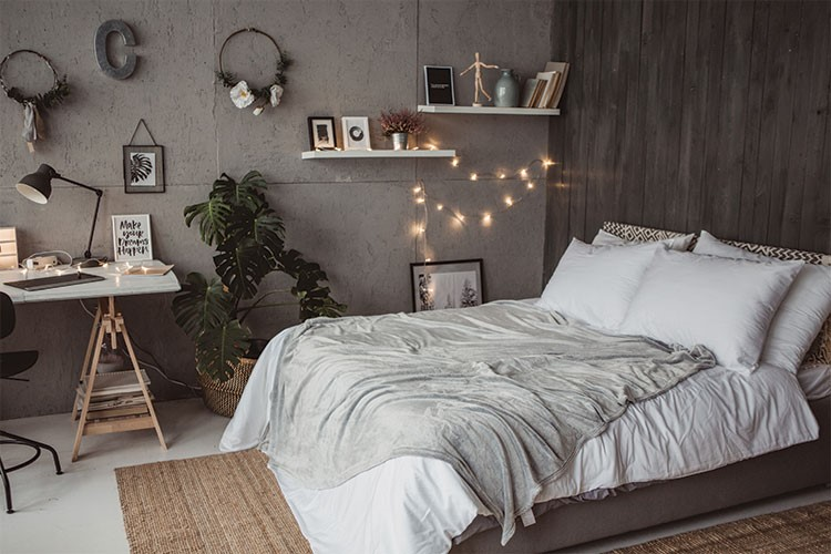 a bed with a white bed spread