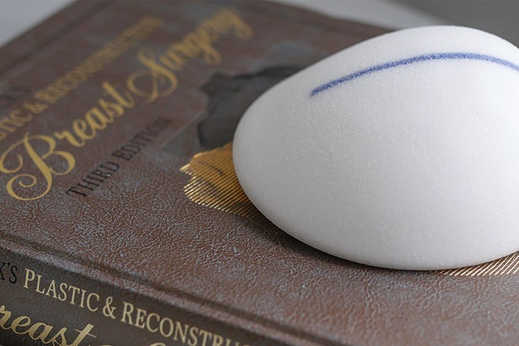 a white mouse on a book