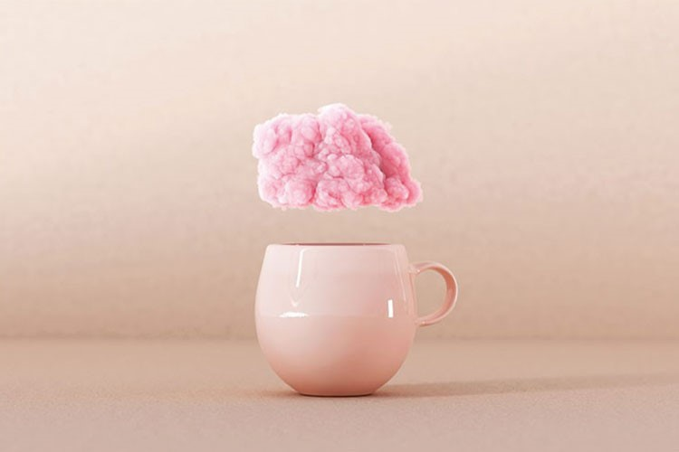 a cup with a pink flower on top