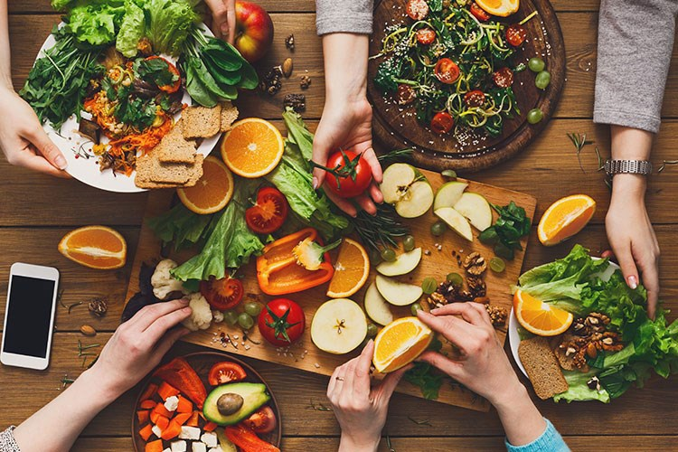 a group of hands holding food