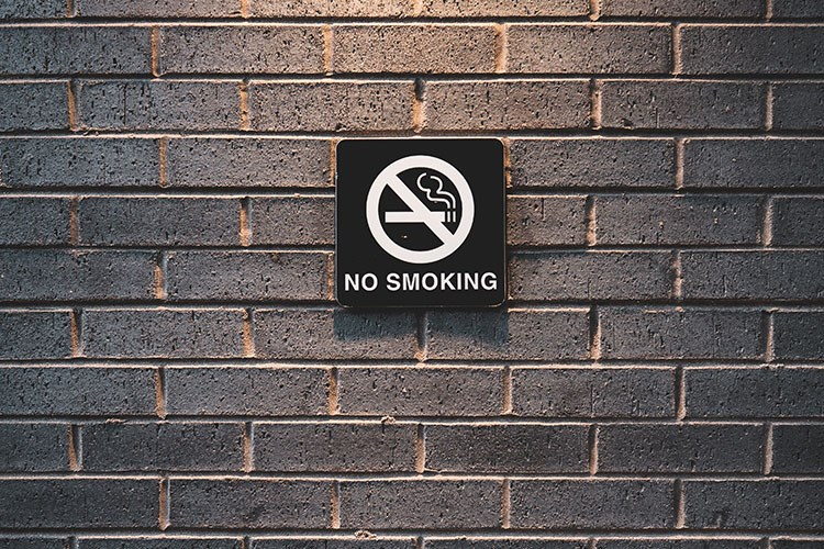 a sign on a brick wall