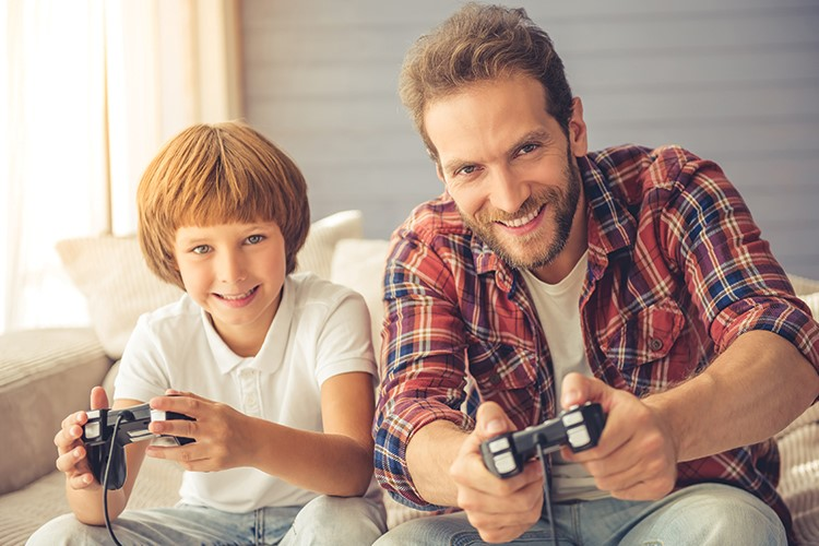 a person and a boy playing video games