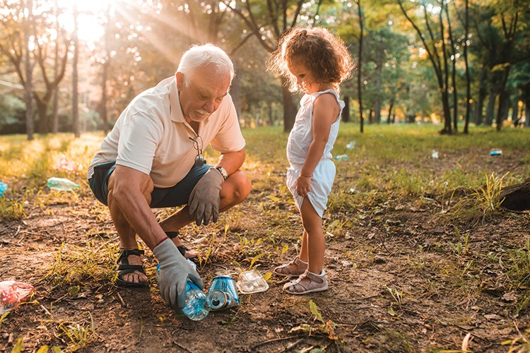an old man and a young girl playing in the dirt