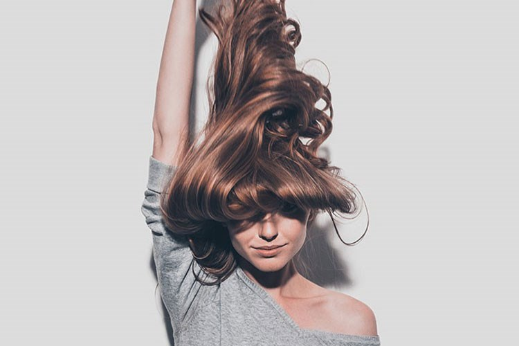 a woman with her hair in the air