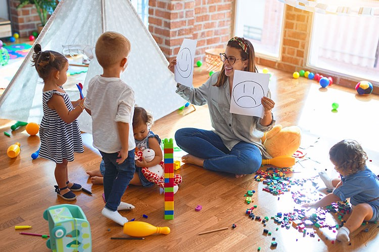 a person and kids playing with toys