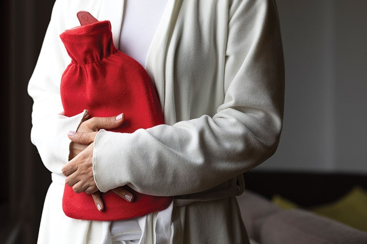 a man holding a red heart